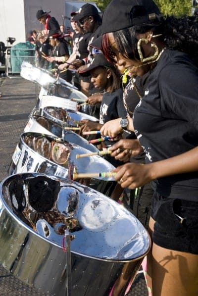 Steel-drummer from CIS Band Trust playing steel drums at the Notting Hill Panorama Championships