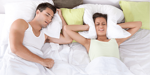 Man snores while women can't sleep