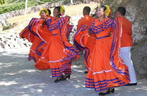 Women perform a traditional dance as they greet visitors at Cayo Levantado