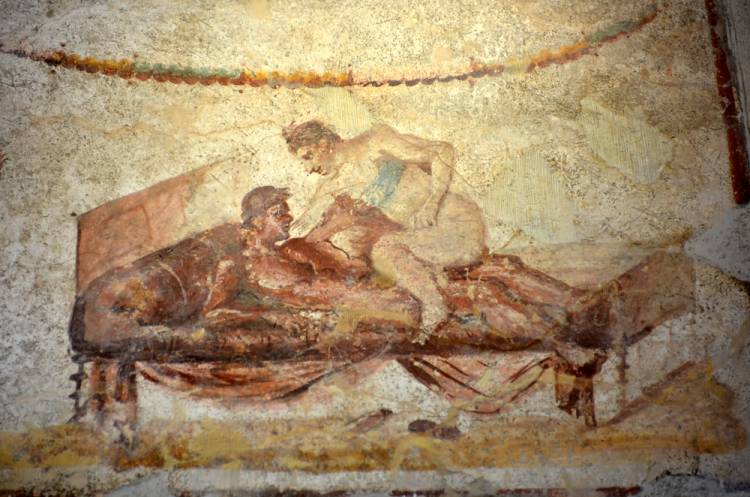 Ancient roman fresco of a service available in a brothel