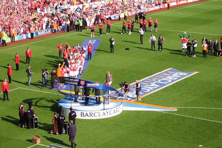 Arsenal captain, Patrick Vieira, being presented with the Premier League trophy at Highbury Stadium, London. Arsenal had beaten Leicester City 2-1, to lift the 2004 League trophy without losing a single match Photo: Alexander Ottesen