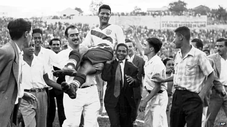Joe Gaetjens being carried aloft after the famous American football victory against England in the 1950 World Cup in Brazil.