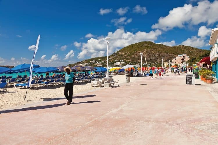An open shopping market off Great Bay Beach. This popular market offers a variety of shops, bar, restaurants and beaches for visiting tourists.