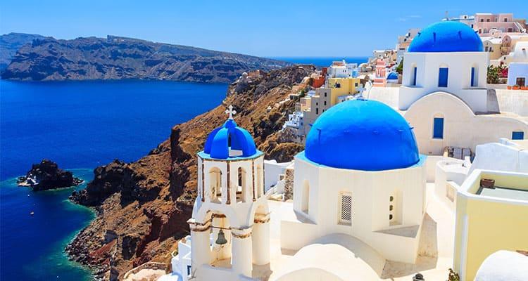 Blue domed churches on the Caldera at Oia on the Greek Island of Santorini