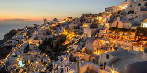 Dusk overlooking buildings on the Caldera at Oia Santorini, Greece
