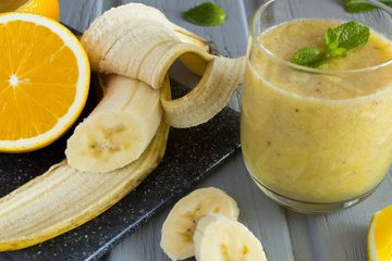 Smoothie and sliced banana and orange