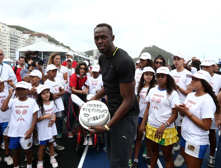 Rio de Janeiro-Brazil August 17, 2014, Usain Bolt runs the 100 meters race during event on Copacabana beach. Photo: A.RICARDO