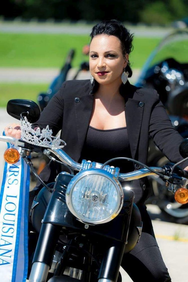 Melissa with her crown on a Harley Davidson