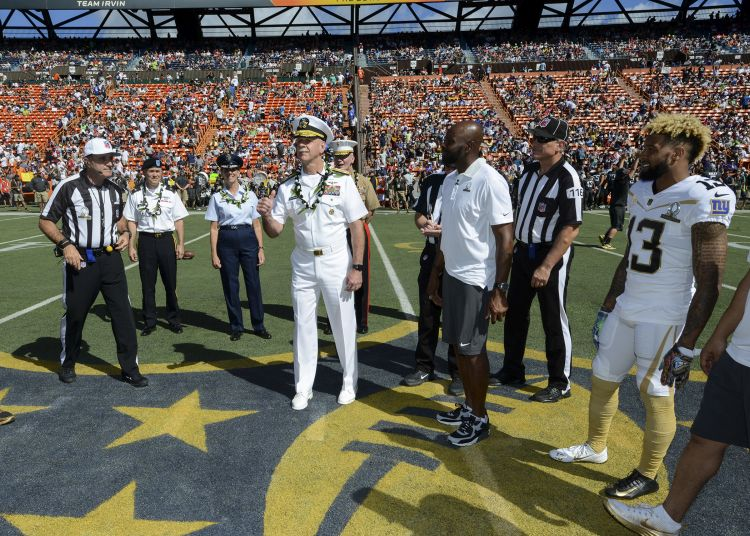 Odell Beckham Jr (on far right) watching Adm. Scott Swift, commander of U.S Pacific Fleet, participating in the opening coin toss during the 2016 Pro Bowl at Aloha Stadium in Honolulu Jan. 31, 2016. Photo: Brian M. Wilbur , U.S. Navy Mass Communication Specialist 2nd Class