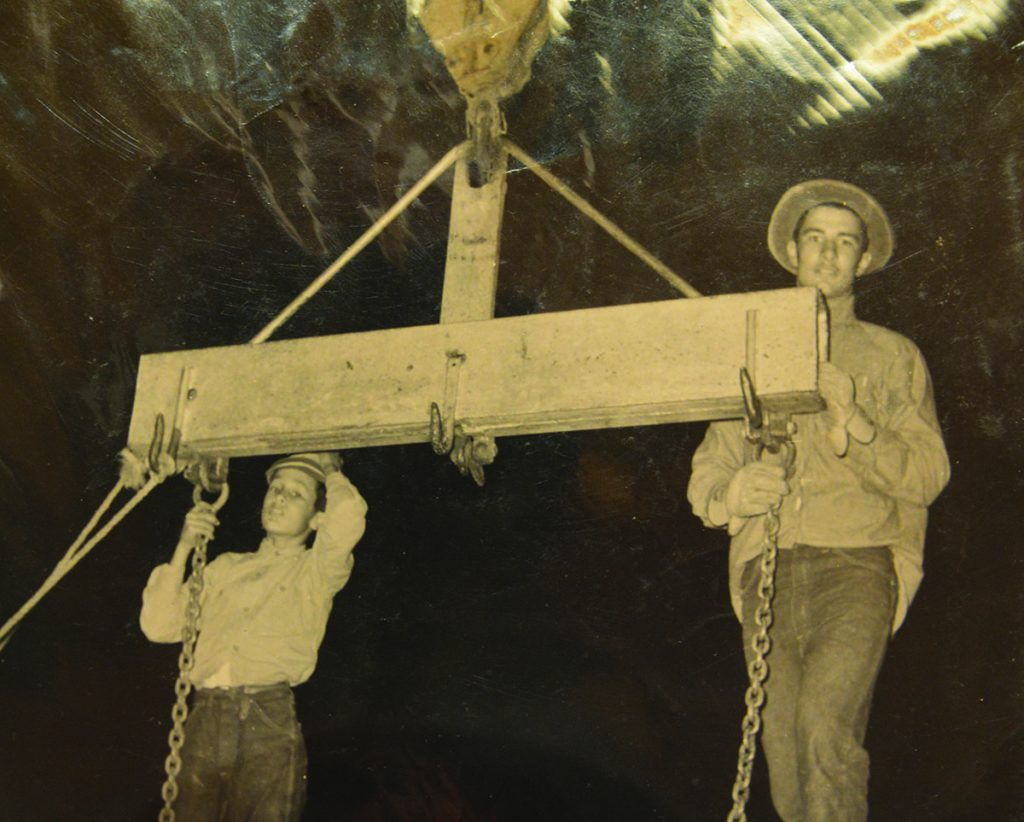 Young Alvin and William holding on to pulley