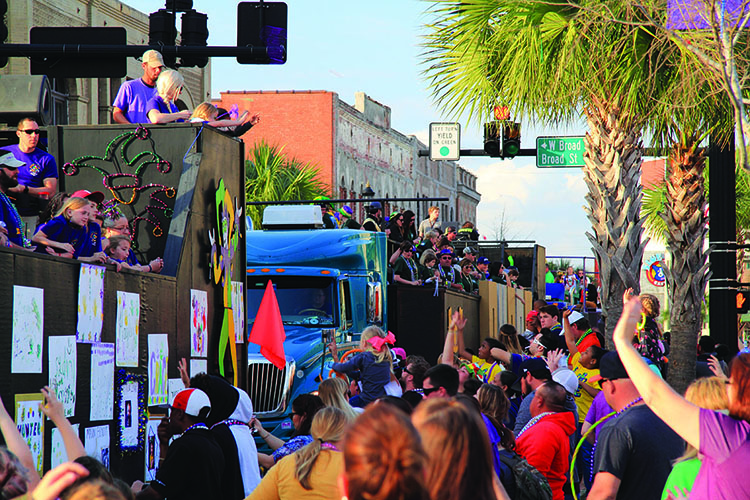 Crowds enjoy a festive atmosphere during Mardis Gras celebrations in downtown Lake Charles, Louisiana. Photo: William Silver
