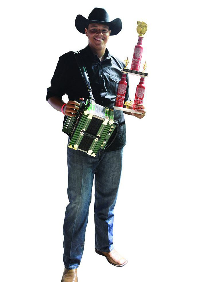TJ, the winner of the 2015 Amateur Accordion Contest at Zydeco Extravaganza. Photo: Rinald Mamachev