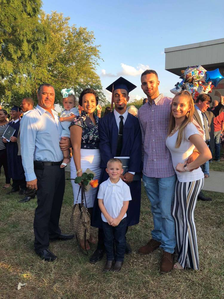 From Left to right: Shannon Anderson Sr holding his granddaugher, Oaklyn Rae Anne Dauphin, his wife Melissa Anderson, Shannon Anderson Jr (Graduate), Jonavon Taylor Dauphin (JT), Jessicca Gotch. In front Jayden Gotch, Shannon and Melissa Anderson's step grandson