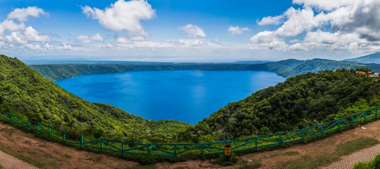 Apoyo Lagoon captured as a panorama & seen from Mirador de Catarina. Lake Nicaragua, the 19th largest lake in the world can be seen in the distance