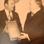 Dr. Francis receives resolution of City Council from Richard J. Daley, Sr. Mayor of Chicago.