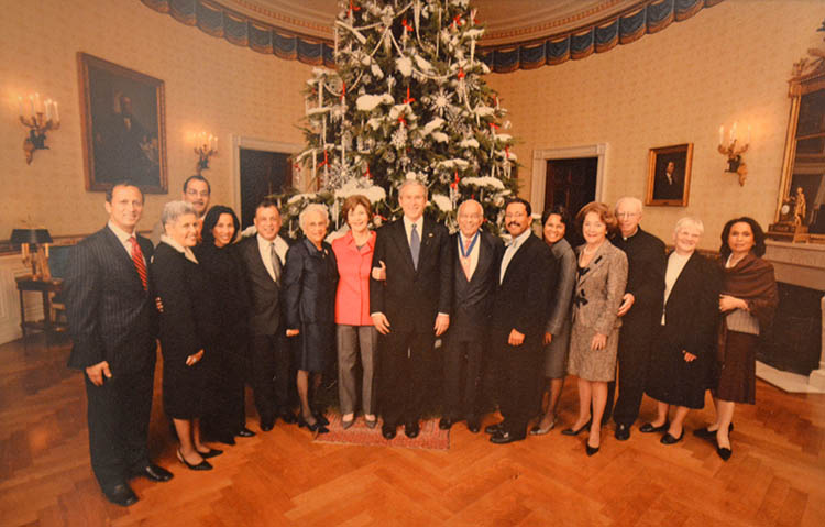 Christmas photo of the family with President George W. Bush.