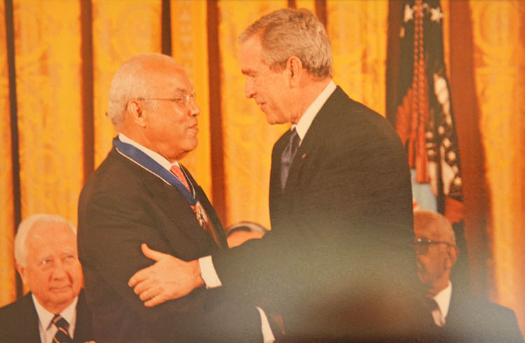 Receiving the Medal of Freedom from George W. Bush in 2006.
