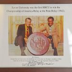 Dr. Francis with Herb Douglas, an American athlete who won the bronze medal in the long jump at the 1948 Summer Olympics in London, presenting the Penn Relays Plaque 1996.